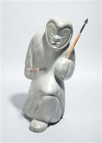 standing hunter, holding a wooden spear in his left hand and a rod for jigging fish in his right by johnassie eyaituq