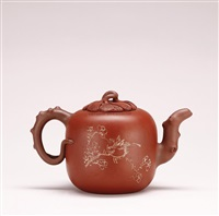 menlon-shaped teapot by jiang zhenxiang