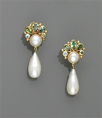 pair of earrings by nadine ifrah leo