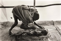 a body being prepared for burial, korem camp, ethiopia, 1984 by sebastião salgado