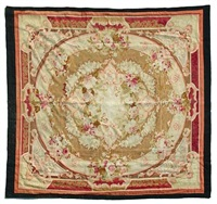 carpet centered by a floral garland by aubusson