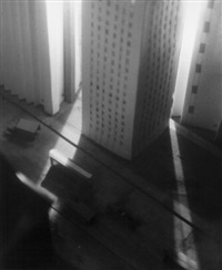 model street scene with skyscrapers and cars by john ahern