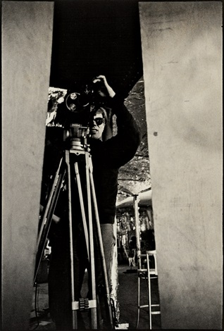 andy warhol behind the film camera at the factory by nat finkelstein