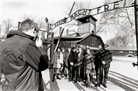 visitor group at auschwitz by michael ruetz
