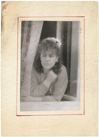 woman leaning outside window by miroslav tichý