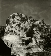 woman's profile and coastal landscape (negative montage) by maurice tabard