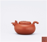 teapot with fish shaped spout and thumb rest by xu xu