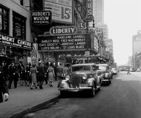 cafe society and the flea circus, 42nd street, new york (from new york images) by joe schwartz