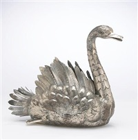 a swan form centerpiece by david ferreira