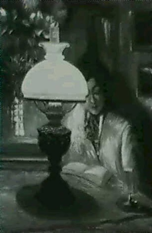 woman reading by lamplight by theodore p modra