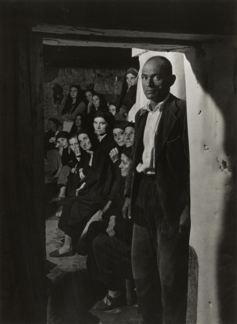 wake man in doorway from spanish village by w eugene smith
