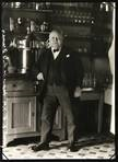hotel owner leaning standing in front of the bar by august sander