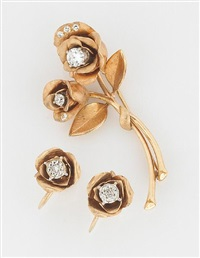 a rose motif brooch and screwback earrings (set of 2) by krementz