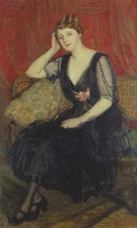 junge frau in schwarzem chiffonkleid, auf einem sofa sitzend by sabine lepsius