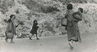 spanish women and children fleeing by robert capa