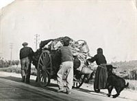 families fleeing in carts by robert capa