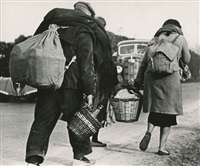 people fleeing barcelona by robert capa