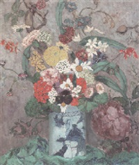 a still life with flowers in a china vase and an elaborate floral wallpaper behind by juliette cambier