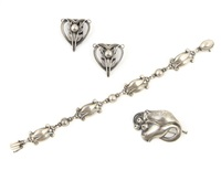 a pair of heart-shaped clips, a bracelet and a tulip pin (set of 3) by georg jensen
