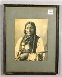 native american holding a peace pipe by frank a. rinehart