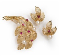 a brooch together with earclips (set of 2) by henry dankner