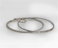 a pair of hoop earrings by fred leighton
