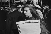 new york city (woman with shopping bag in front of russell stover) by garry winogrand