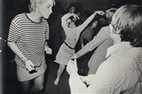 woman dancing freely at museum opening by garry winogrand