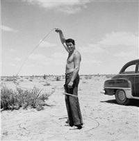 rock hudson with lasso on the set of giant by frank worth