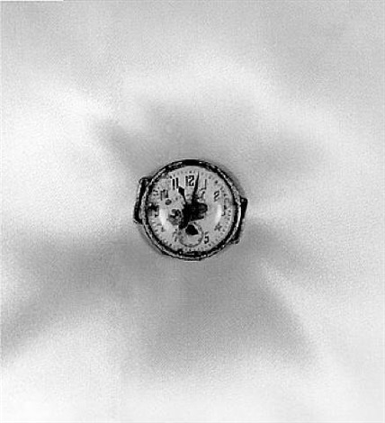 a wristwatch dug up approximately 0.7 km from the epicenter of the explosion. nagasaki, 1961 by shomei tomatsu