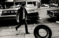 bob dylan (with tire), new york, 1963 by jim marshall