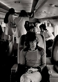 mick jagger (on airplane), 1972 by jim marshall