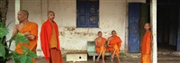 monks resting at their temple, luang prabang, laos by neil meyerhoff