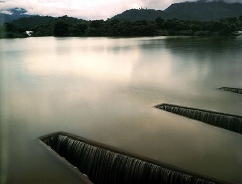 'sluices at a reservoir, part of a two-thousand-year-old irrigation system now updated,' near badulla, sri lanka by virginia beahan & laura mcphee