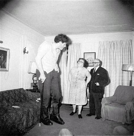 a jewish giant at home with his parents in the bronx, n.y., 1970 by diane arbus