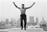 Muhammad Ali jumping from a bridge over the..., 1966