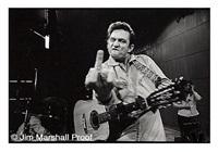 johnny cash (flipping the bird), san quentin prison, 1969 by jim marshall
