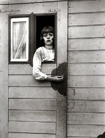 girl in a circus caravan by august sander