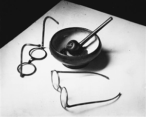 glasses and pipe by andré kertész