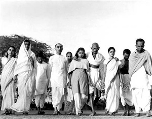 gandhi walking with close advisors and family members, india by margaret bourke-white