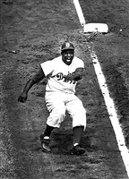 jackie robinson rounding third base during world series against the yankees by life photographers