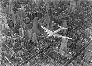 a dc-4 flying over new york city by margaret bourke-white