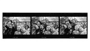 "three frames from the negative strip of ""children at a puppet theater, paris by alfred eisenstaedt"