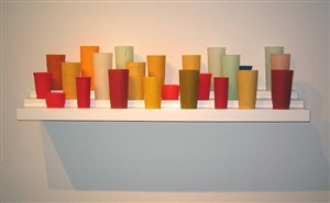 untitled (24 cups on a 40 inch 3 tier shelf) by george stoll