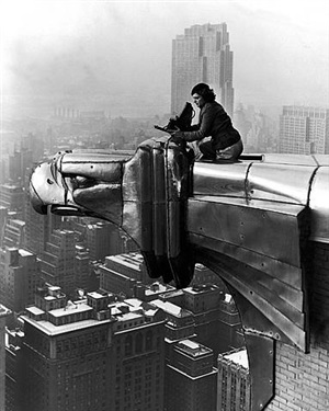 margaret bourke-white working atop the chrysler building, new york, ny; photographed by her assistant, oscar graubner by margaret bourke-white