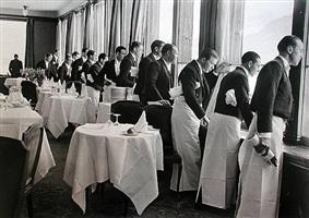 waiters watching sonya henie skate, st. moritz by alfred eisenstaedt