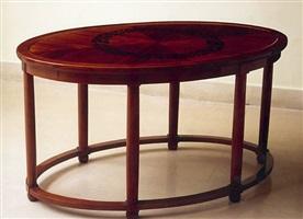 table ovale à six pieds en palissandre décorée d'une guirlande de fleurs en bois de rose by andré groult