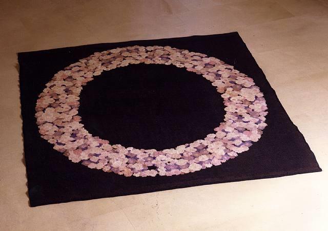 tapis en laine à fond violet présentant un décor d'une guirlande de fleurs by émile jacques ruhlmann