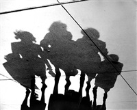 untitled (shadows of four women on pavement) by marvin newman