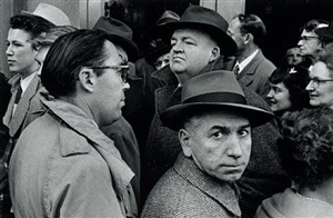 man looks at camera in crowd by william klein